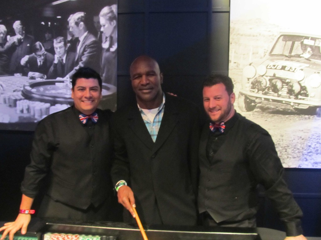 Evander Holyfield with our Craps Dealers in New York City Superbowl Party