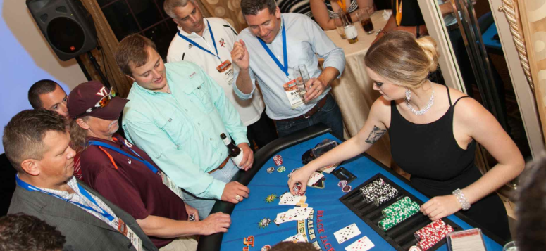 People Playing Black Jack At Casino Night James Bond Party